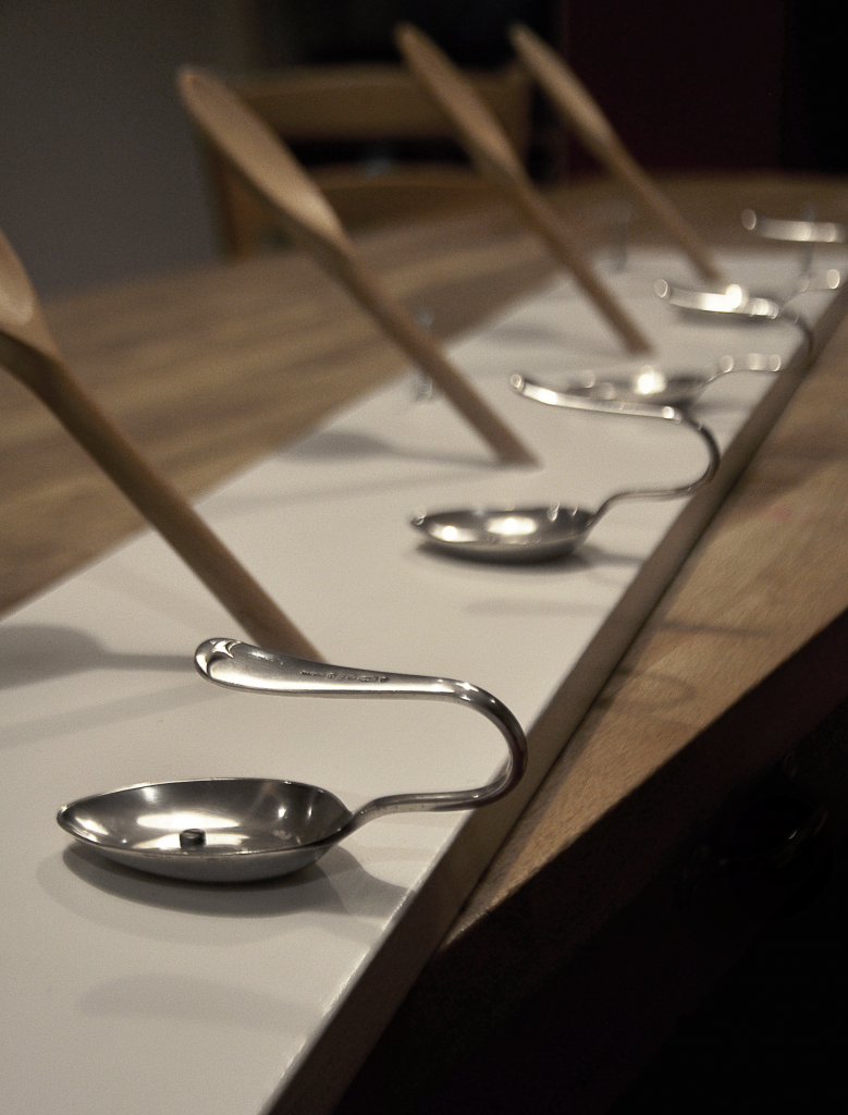 Assembled wooden and silver spoon coat rack