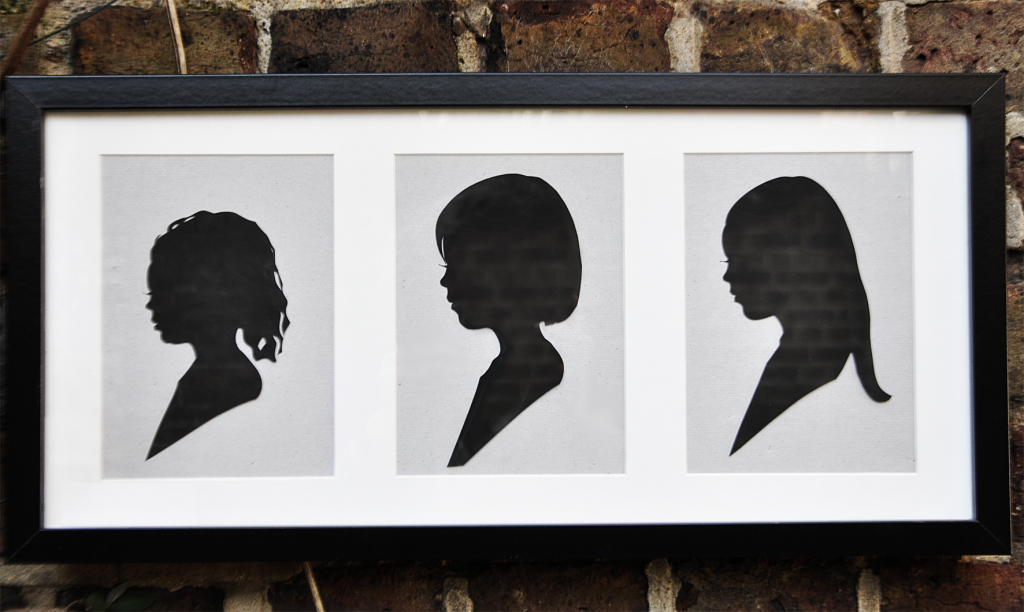 Three silhouettes of girls