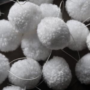 Strung white snowball pom poms. Dougie Scott