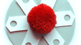 Punched shapes and pom pom to make snowflake tag. Dougie Scott